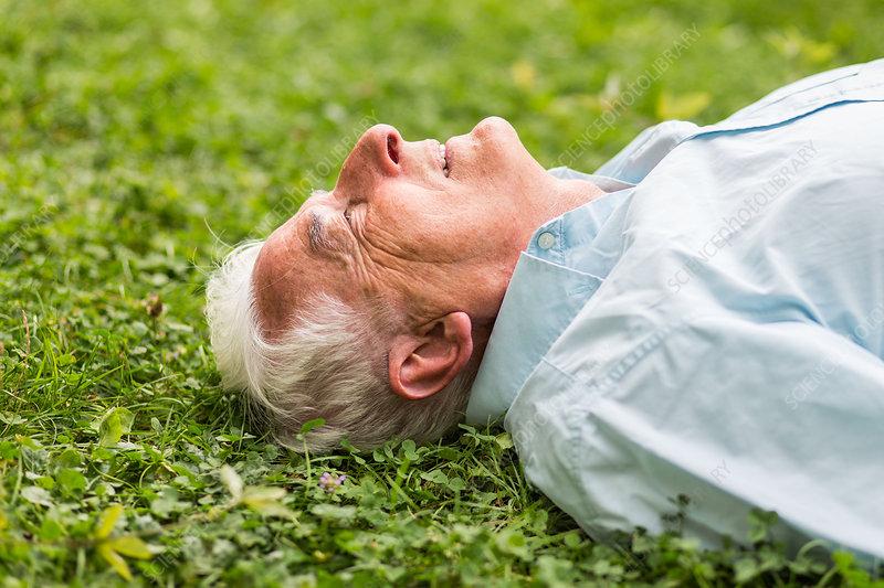 Man lying on lawn