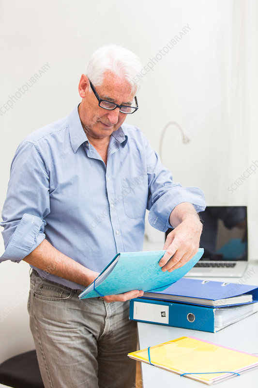 Man with administrative papers