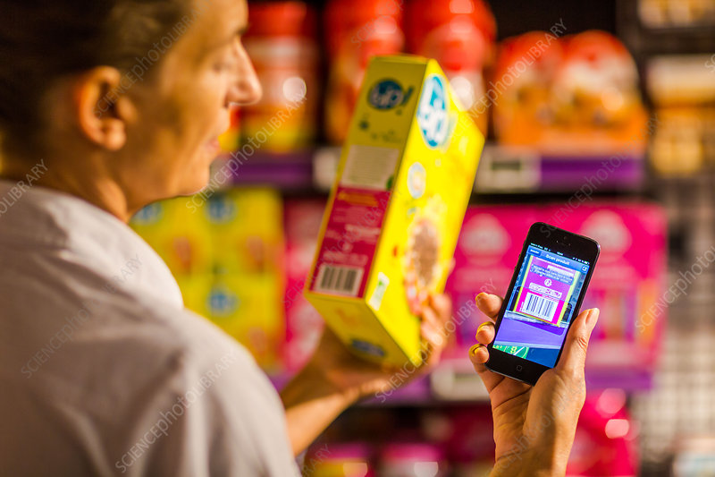 Woman using a smartphone in supermarket