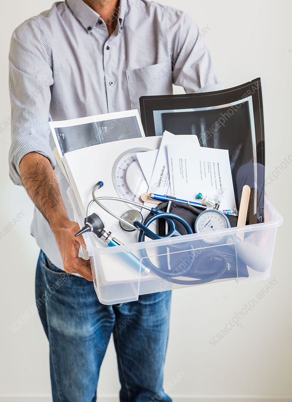 Man with medical folders, scans and tools