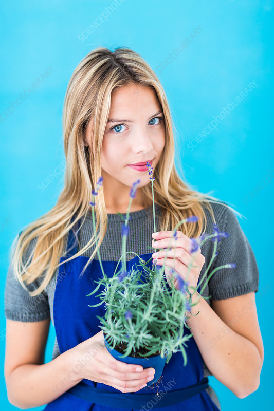 Woman smelling the scent of lavender