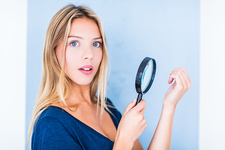 Woman using a magnifying glass