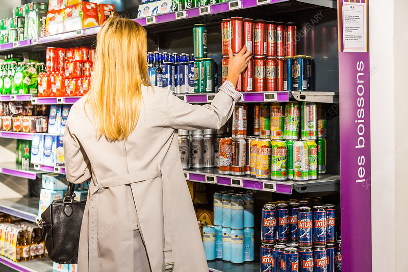 Woman in a supermarket Liquors section