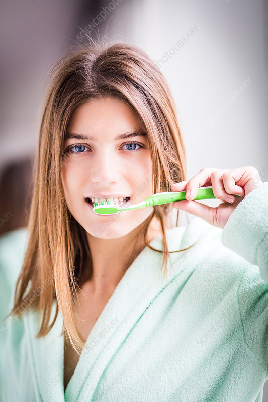 Woman brushing her teeth with toothbrush