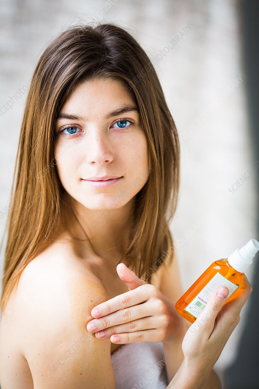 Woman using carrot oil