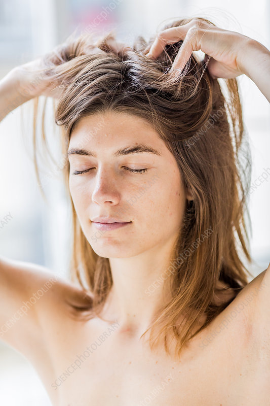 Woman massaging her scalp