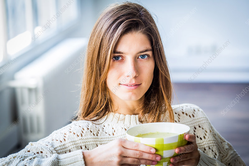 Woman eating soup
