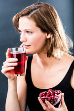 Woman drinking a glass of cranberry juice