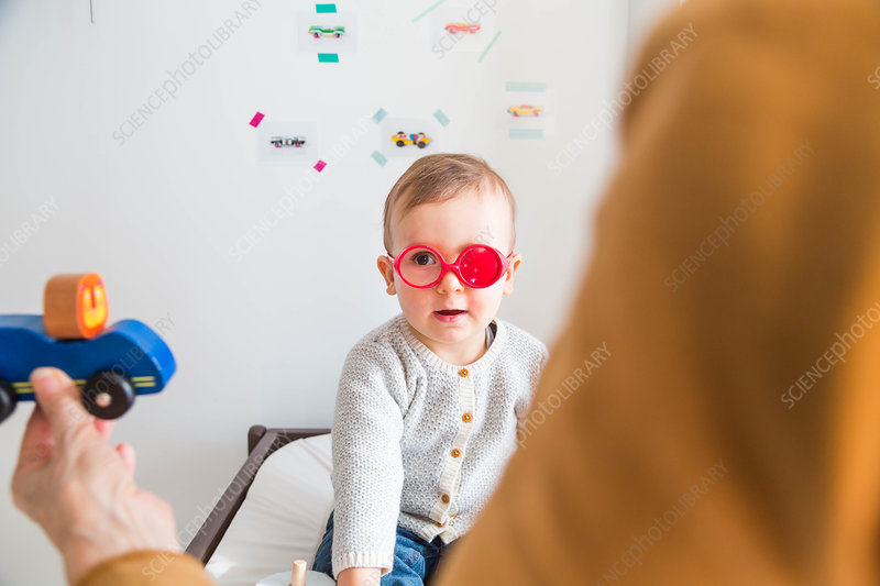Baby having his sight tested