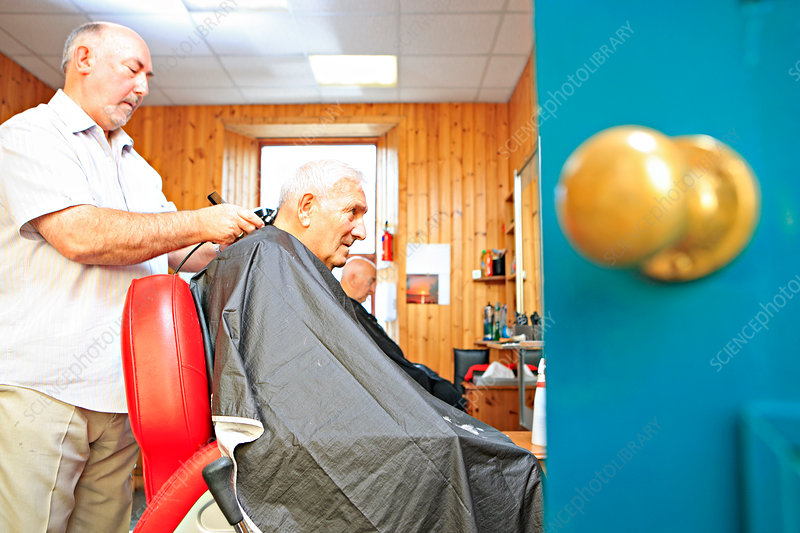 Man with dementia having his hair cut