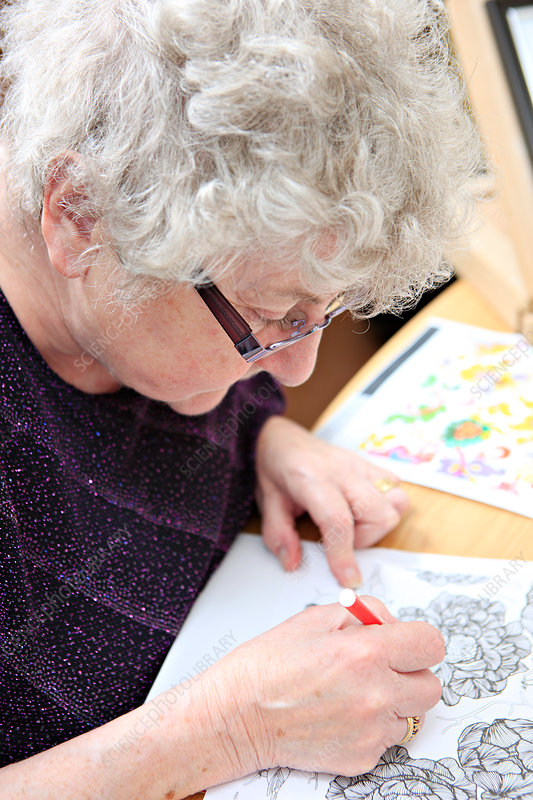 Woman with dementia at an art therapy group