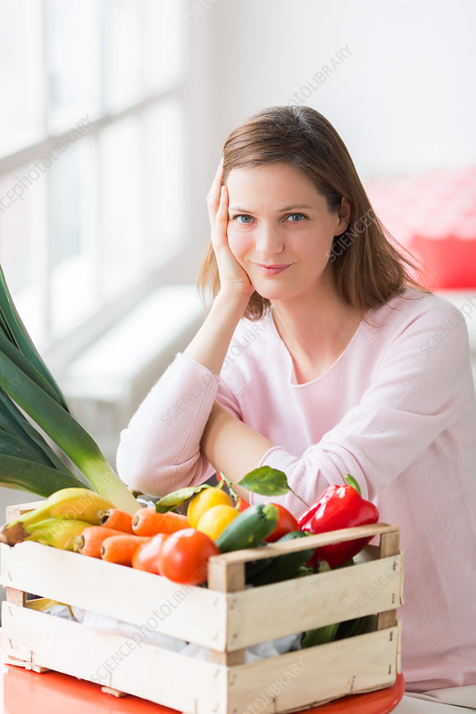 Woman with vegetables basket