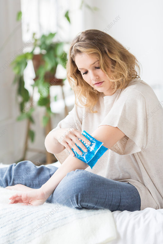 Woman using a hot-cold gel pack