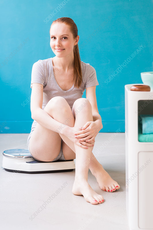 Woman sitting on scales