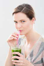 Woman drinking a wheat grass juice