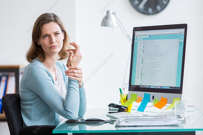 Woman at work suffering from wrist pain