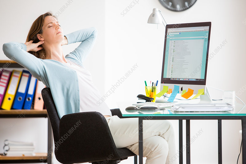 Office woman stretching arms at work