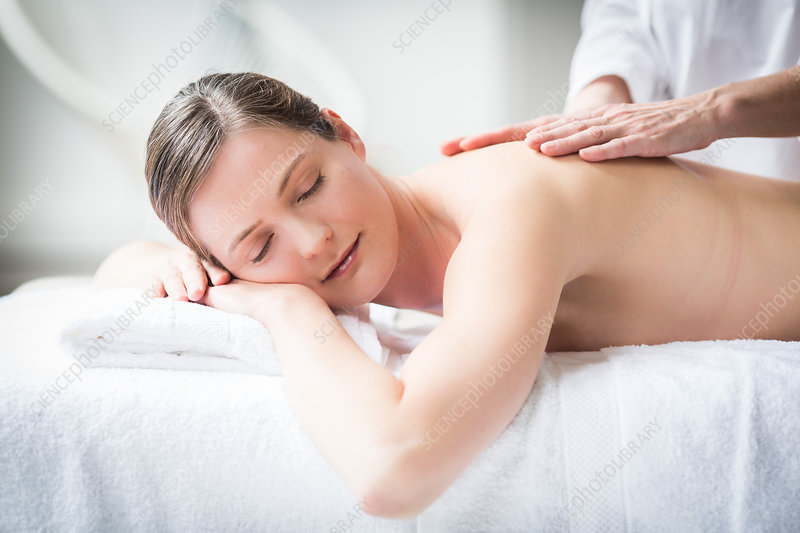 Woman receiving a back massage