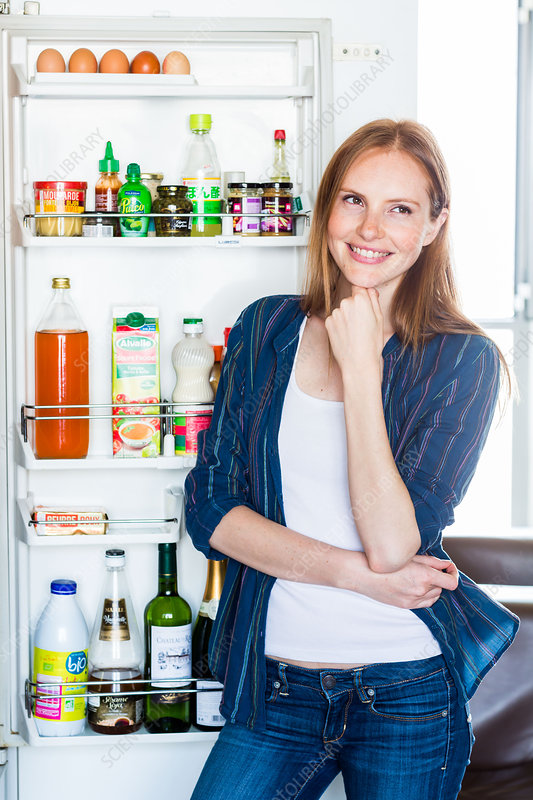 Woman in front of a refrigerator