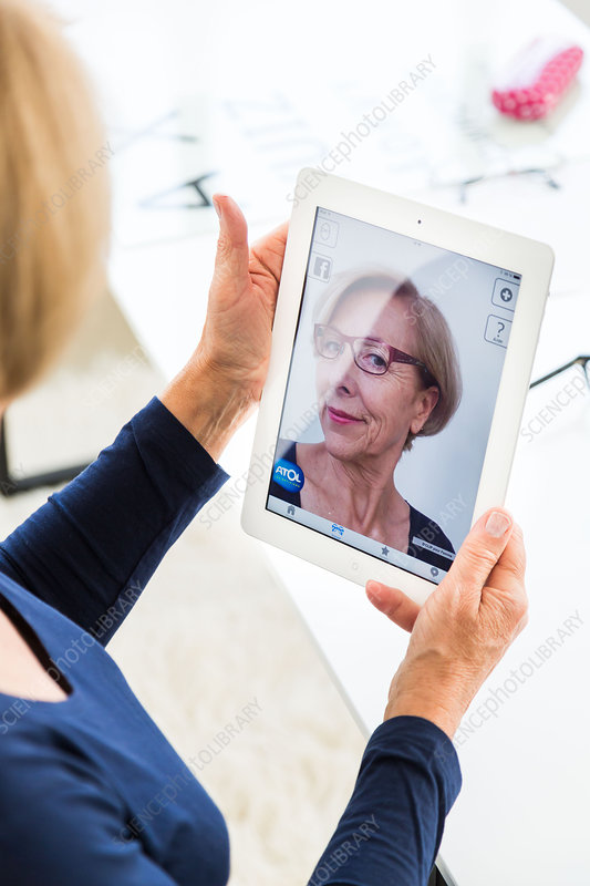 Woman virtually trying on eyeglasses