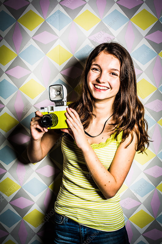 Teenage girl using a camera