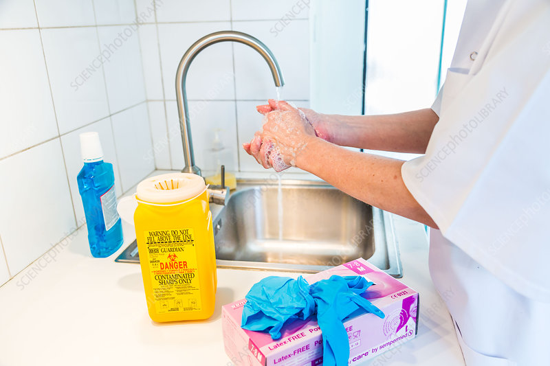 Health professional washing hands