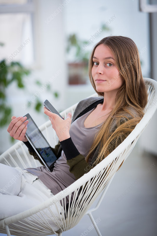 Woman using tablet and smartphone