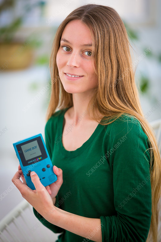 Woman playing with video game console