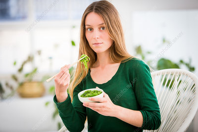 Woman eating edible seaweed