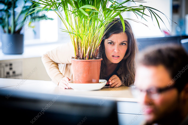 Woman watching her colleague in the office