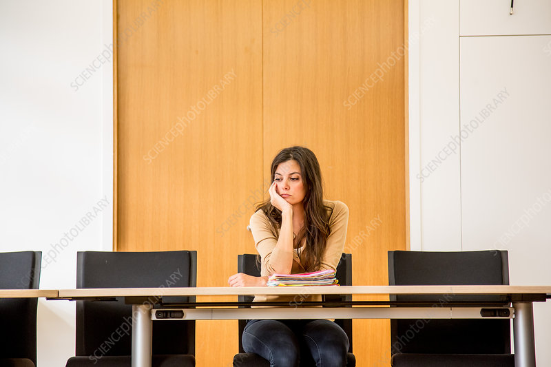 Woman alone in a conference room