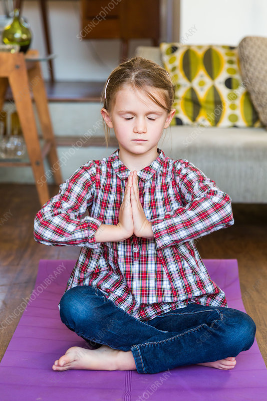 6 year-old girl practicing relaxation exercises