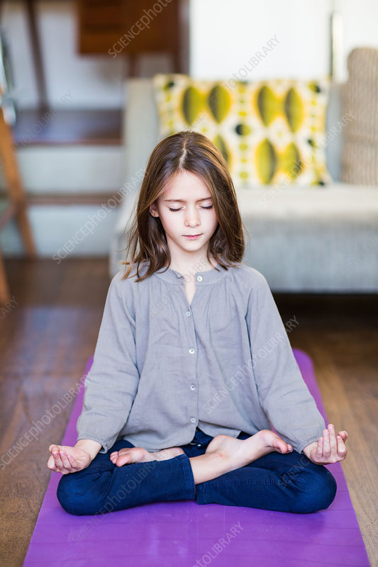 8 year-old girl practicing relaxation exercises