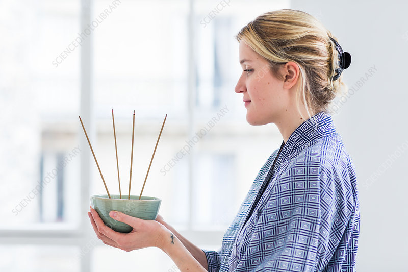 Woman burning incense