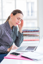 Woman at work suffering from headache
