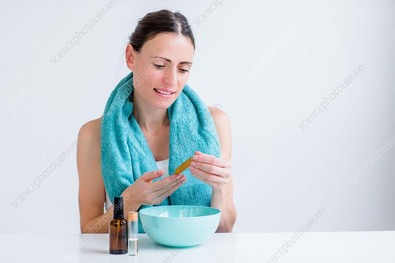 Woman treating nasal congestion