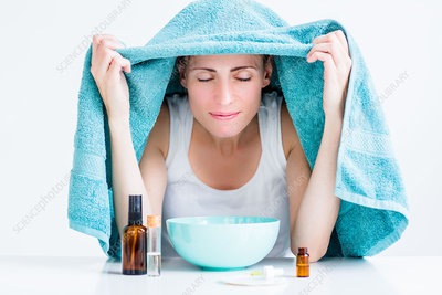 Woman treating nasal congestion