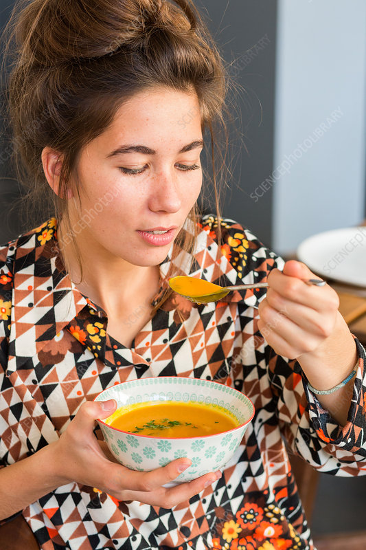 Woman eating a soup