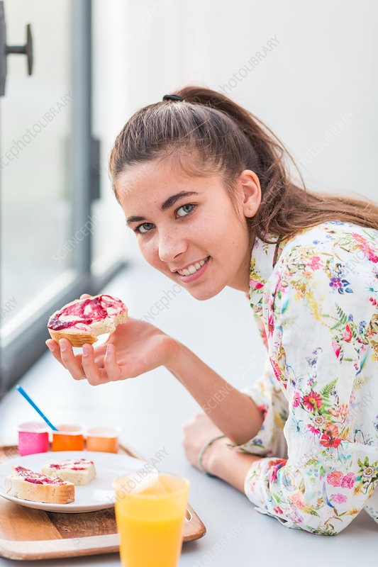 Woman eating jam on bread