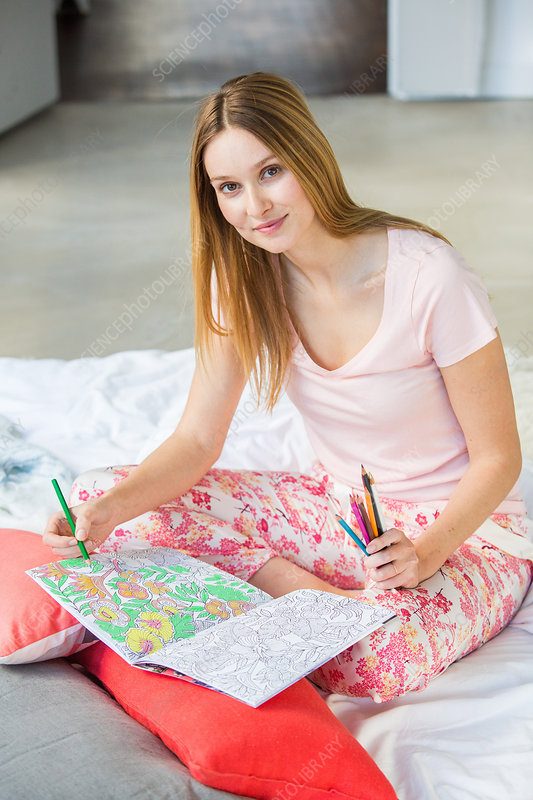 Woman colouring a mandala