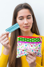 Woman holding oral contraception pill