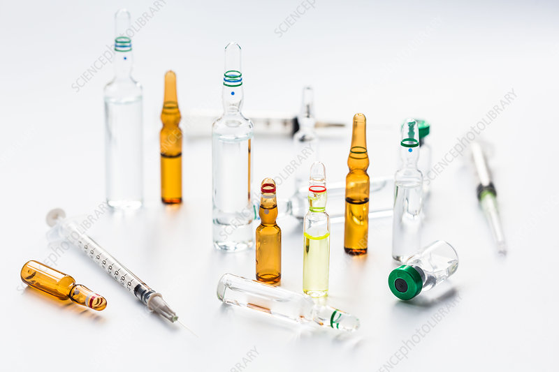 Ampoule next to a syringe
