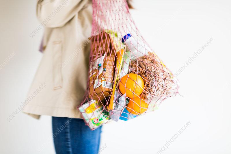 Woman holding net shopping bag