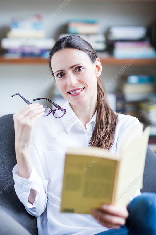 Woman with glasses reading a book