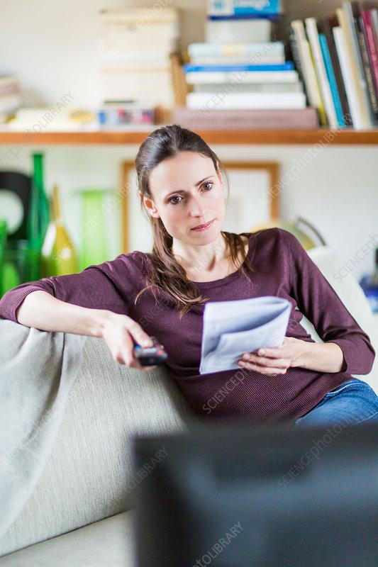 Woman reading TV manual