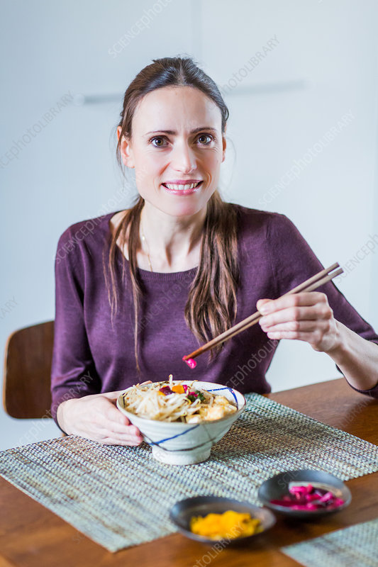 Woman eating a Japanese salad