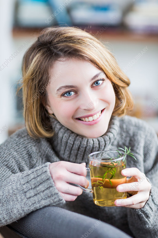 Woman drinking rosemary tea