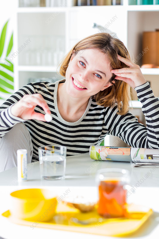 Woman taking an effervescent tablet