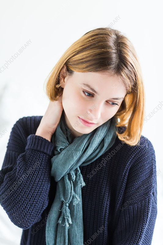 Woman suffering from neck pain