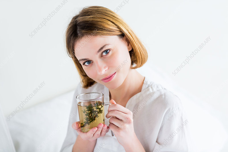 Woman drinking a thyme tea